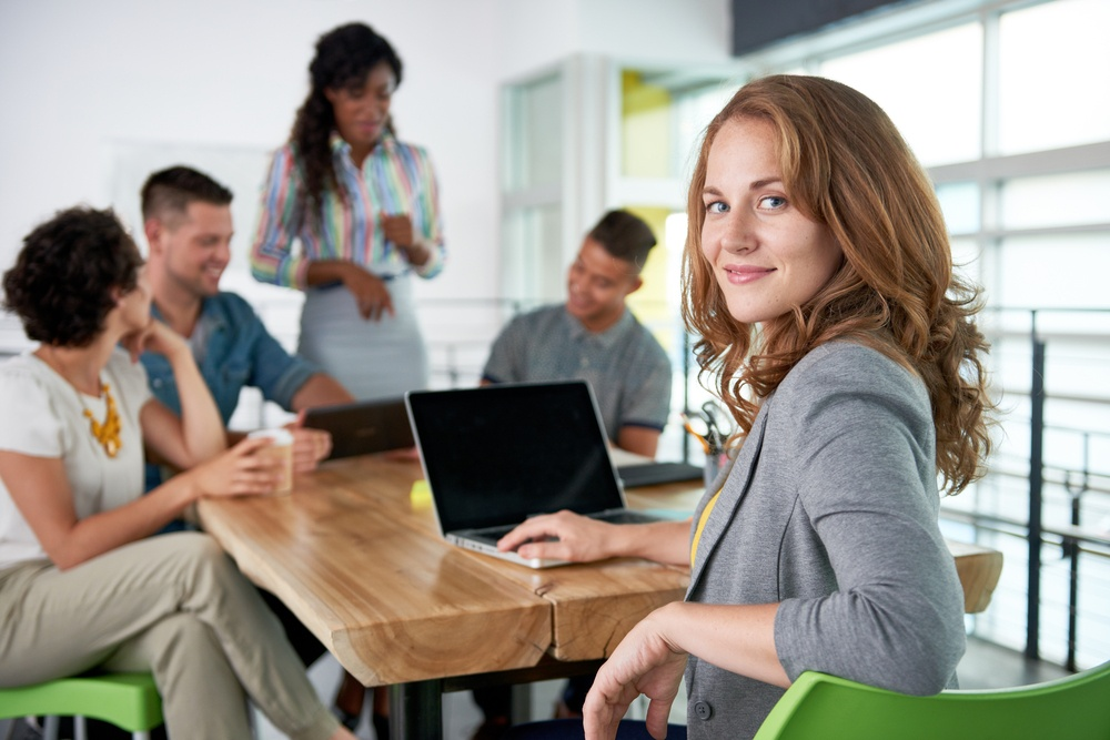 Image of a succesful casual business woman using laptop during meeting-1.jpeg
